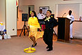 US Navy 071010-N-3202N-002 Hospital Corpsman 2nd Class Alejandro Alcala and Mrs. Elizabeth Taylor performs the Mexican Hat Dance in celebration of the Hispanic Heritage Month at U.S. Naval Hospital Sigonella.jpg