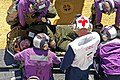 US Navy 071109-N-6597H-306 Aviation boatswain's mates prepare to transport a simulated causality to the medical department aboard amphibious assault ship USS Tarawa (LHA 1) during firefighting training.jpg