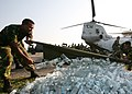 US Navy 071123-M-7696M-096 Bangladeshi soldiers use a stretcher to unload a shipment of bottled water delivered by Marines of Marine Medium Helicopter Squadron (HMM) 261, the aviation element of the 22nd Marine Expeditionary Un.jpg