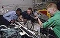 US Navy 080111-N-0455L-004 Aviation Support Equipment Technician Airman Shounie Capers, left, Aviation Support Equipment Technician 3rd Class William Byrum and Aviation Support Equipment Technician 3rd Class James Calderis repl.jpg