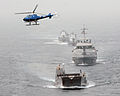 US Navy 080202-N-8933S-006 Landing Craft Utility (LCU) 1655 leads the Equatorial Guinea Navy in formation behind Africa Partnership Station (APS) flagship USS Fort McHenry (LSD 43), a dock landing ship, as they pass along the E.jpg