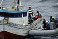 US Navy 080610-N-8649C-001 Sailors assigned to the guided-missile destroyer USS Forrest Sherman (DDG 98)assist crew members of the Peruvian fishing vessel Salcantay after the small craft became stranded 20 miles offshore.jpg