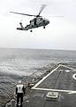 US Navy 080709-N-1082Z-059 Boatswain's Mate 1st Class Stephen Graham serves as flight deck safety observer.jpg