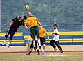 US Navy 080806-N-7031M-305 Gunner's Mate 2nd Class James Duggan, a guided-missile destroyer USS Curtis Wilbur (DDG 54) Sailor, and a Royal Malaysian Navy sailor rise above the rest in a friendly game of soccer.jpg