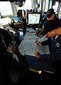 US Navy 080822-N-4044H-060 Quartermaster 2nd Class Carlos Oqendo plots points on the navigation chart aboard the guided-missile destroyer USS McFaul (DDG 74).jpg