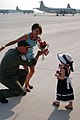 US Navy 090610-N-3666B-002 Patrol Squadron Eight (VP-8) Commanding Officer Cmdr. Wes Naylor greets wife and daughter after returning home on VP-5's last plane from deployment.jpg