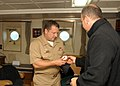 US Navy 090709-N-2000D-052 Capt. Brad Williamson, commodore of Destroyer Squadron (DRSRON) 2 and mission commander of Southern Partnership Station '09, exchanges gifts with Cmdr. Pablo Silva, commanding officer of the Uruguayan.jpg