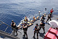 US Navy 090915-N-1938G-029 A U.S. Navy boarding team from the guided-missile frigate USS Doyle (FFG 39) secures the fantail of USCGC Mohawk (WMEC 913) during a simulated Maritime Interdiction Operation in the Caribbean Sea.jpg