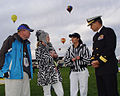 US Navy 091003-N-2888Q-003 Rear Adm. Paul Bushong, commander of Submarine Group 2, right, talks with flight controllers and balloon pilot, retired Brig. Gen. Mike Rice, left, at the Albuquerque International Balloon Fiesta.jpg