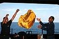 US Navy 091122-N-8960W-011 Logistics Specialist Seaman Michael Gonsalves tosses a mailbag to Logistics Specialist 3rd Class Stephen Alexander.jpg