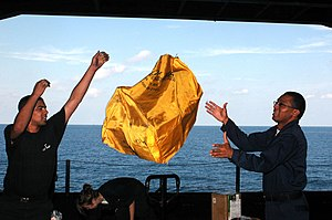 Mail pouch - tossing a military mail pouch at sea