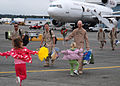 US Navy 091124-N-9860Y-001 t. Tom Barlow, from American Fork, Utah, assigned to the Fighting Marlins of Patrol Squadron (VP) 40, is greeted by his daughters during a homecoming for VP-40.jpg