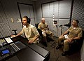US Navy 100514-N-7227H-012 Rear Adm. Craig Faller and Senior Chief Mass Communication Specialist Tom Jones conduct sound checks as Rafal Dziedziniewicz adjusts the recording levels before beginning a podcast.jpg