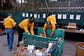 US Navy 110125-N-6778P-016 Sailors elp the Metropolitan Ministries in sorting out donated food that will feed homeless families during Tampa Bay Na.jpg