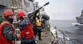 US Navy 110315-N-4392R-044 Gunner's Mate 2nd Class Levi Delker fires a line from the guided-missile destroyer USS John S. McCain (DDG 56) to the Mi.jpg