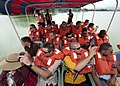 US Navy 110924-N-HA376-092 Sailors assigned to the mine countermeasures ship USS Defender (MCM 2) take pictures on Kaptai Lake during sightseeing t.jpg