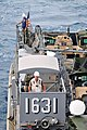 US Navy 111001-N-KM175-004 Landing Craft Utility 1631, assigned to Beachmaster Unit (BMU) 1, prepares to enter the well deck of the forward deploye.jpg