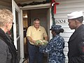 US Navy 111214-N-GO535-026 A Sailor distribute Christmas presents to homebound and elderly people.jpg