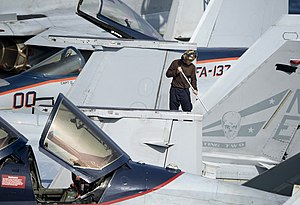 US Navy 120105-N-JN664-062 A Sailor cleans an F-A-18F Super Hornet assigned to the Bounty Hunters of Strike Fighter Squadron (VFA) 2 aboard the Nim.jpg