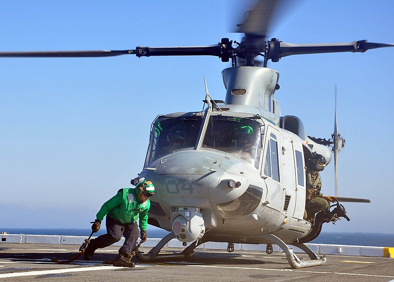 File:US Navy 120202-N-VL218-003 Aviation Support Equipment Technician Airman Apprentice Robwil Valderreylabrador secures a UH-1Y Huey helicopter from Ma.jpg