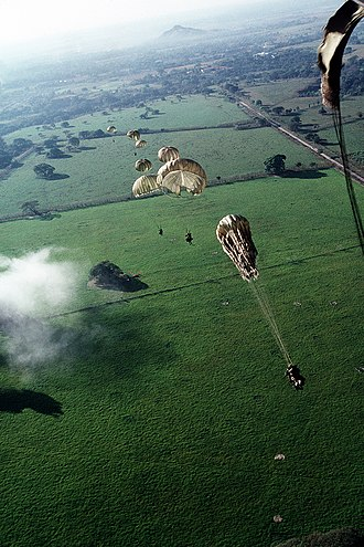 United States invasion of Panama - Elements of 1st Bn, 508th Infantry parachuting into a drop zone, during training, outside of Panama City.