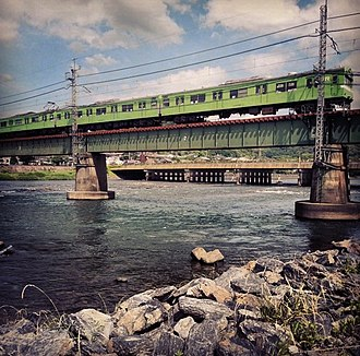 Yodo River - JR Nara Line train crossing the Uji River on the rail bridge in Uji, Japan