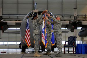 "Seventeenth Expeditionary Air Force - Army General William E. ""Kip"" Ward (left), U.S. Africa Command commander, and Maj. Gen. Ronald R. Ladnier, commander of Seventeenth Air Force, unfurl the Seventeenth Air Force's guidon during an assumption-of-command ceremony at Ramstein Air Base, Germany."