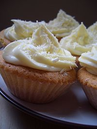 Vanilla cupcakes with lemon and mascarpone frosting and white chocolate curls.jpg