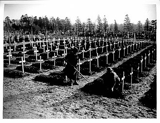 British war cemetery in early 1918 with temporary crosses at Abbeville, France WWI British cemetery at Abbeville.jpg