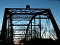 War Eagle Bridge in silhouette.jpg