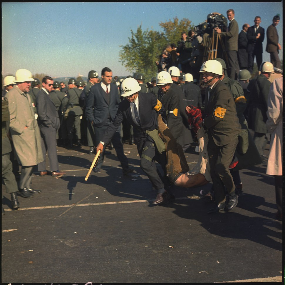 Washington D.C. Anti-Vietnam Demonstration. U.S. Marshals bodily remove one of the protesters during the outbreak of... - NARA - 530620