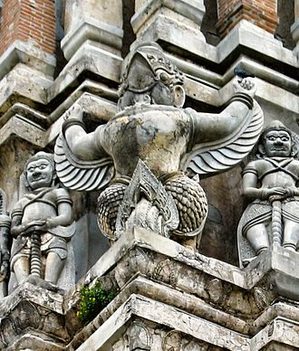 Emblem of Thailand - A Garuda decoration on the prang of the 15th century Wat Ratchaburana, Ayutthaya Historical Park.