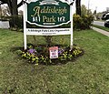 Welcome sign to the Addisleigh Park Historic District. Sign erected by the Addisleigh Park Civic Organization.jpg
