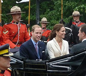 2011 royal tour of Canada - The couple surrounded by Royal Canadian Mounted Police officers in Charlottetown, Prince Edward Island