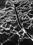 Wind-class icebreakers cut path through Arctic ice field c1959.jpg