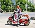 Woman on motorcycle. Kashgar. 2011.jpg