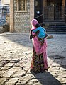 Woman with a pink scarf and a baby, Rajasthan (6358621701).jpg