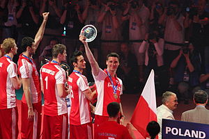 Poland men's national volleyball team - On the podium of the World League 2011 with bronze medals. The captain of Poland, opposite Piotr Gruszka is holding a trophy.