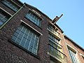 Wuppertal, Friedrich-Engels-Allee 161b, Fabrik, Treppenhaus-Risalit, Obergeschosse und Kragbalken.jpg