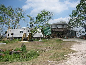 FEMA trailer (at left) alongside a Katrina-dam...