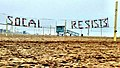 """SOCAL RESISTS"" banner on beach volleyball court in Manhattan Beach, CA February 20th, 2017.jpg"