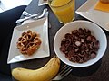 (glass of orange juice a banana a waffle Breakfast cereal with milk).jpg