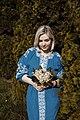 День Вишиванки. Молода україночка у вишитій синій сукні серед квітів 13.jpg