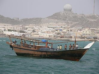 Masirah Island - A dhow with the island in the background