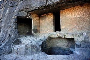 Ghorawadi Caves - Unoccupied Vihara and cistern.