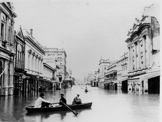 1893 Brisbane flood - Queen Street, one of the major roads in Brisbane, after the 1893 floods. Residents are seen rowing boats to move about due to the flooding.