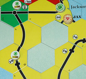 18XX - A game of 18FL in progress, depicting the gameboard with track tiles and station tokens