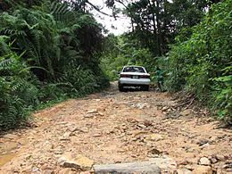 1986-1991 Toyota Camry sedan on road to Bokor Hill Station, Cambodia.jpg