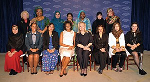International Women of Courage Award - The honorees, presenters and guests at the 2012 International Women of Courage Awards, March 8, 2012. Back row, from left: Melanne Verveer (guest), Leymah Gbowee (guest), Shad Begum, Aneesa Ahmed, Hawa Abdallah Mohammed Salih, Samar Badawi, Tawakel Karman (guest).  Front row, from left: Maryam Durani, Pricilla de Oliveira Azevedo, Zin Mar Aung, Michelle Obama, Hillary Clinton, Jineth Bedoya Lima, Hana Elhebshi, Şafak Pavey