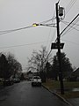 2014-12-24 15 22 08 Sodium vapor street light on an older support on Boone Avenue in Ewing, New Jersey.JPG